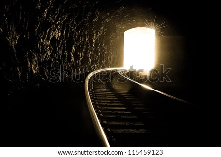 This image brings about hope and strength. In difficult times it is important to keep your faith and hope and reach for the light at the end of the tunnel. - stock photo