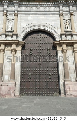 This image show a Cathedral Door near the Plaza Mayor, Lima, Peru - stock photo