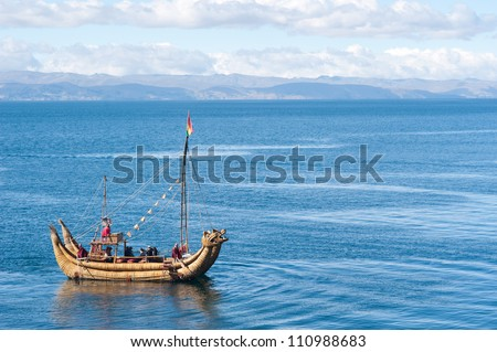 This image shows a reed boat off  Isla del Sol, Bolivia - stock photo