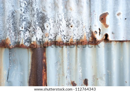 This image shows the detail of a tin wall on Cockatoo Island,  Sydney, Australia. - stock photo
