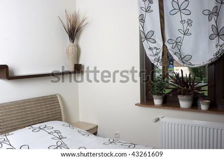 This inviting, warm bedroom suite offers rest for the weary - stock photo