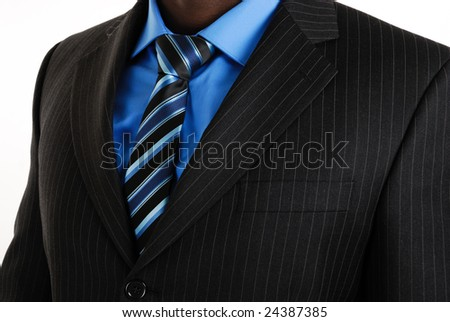 This is a an image of business man wearing a tie, shirt and suit. - stock photo