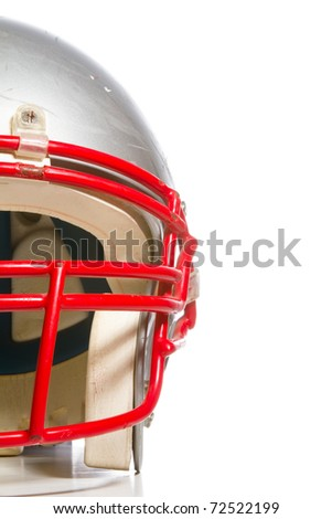 This is a close up shot of half of an old, scratched up football helmet. Shot on a white background. - stock photo