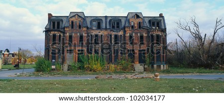 This is a deserted building in a bad part of town. It shows the urban wasteland of Detroit. - stock photo