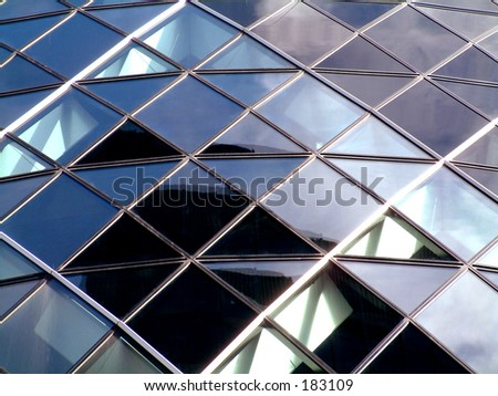 This is a image of the modern building called the Gherkin which is in London. - stock photo