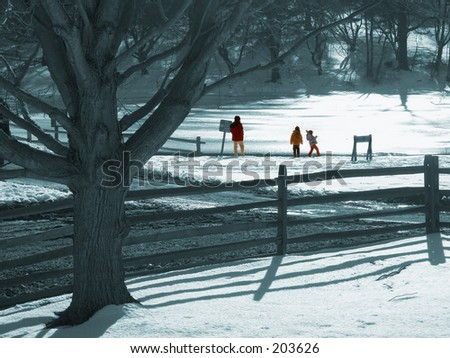 This is a mostly toned photo of some kids throwing stones upon a frozen lake. - stock photo