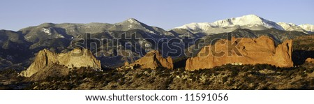 This is a panoramic view of the Garden of the Gods and Pikes Peak at sunrise, near Colorado Springs, Colorado. - stock photo