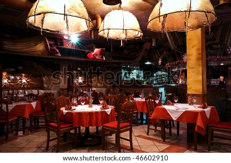 This is a photograph of a restaurant interior - stock photo