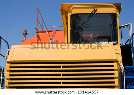 This is a picture of a heavy duty dump truck which is typically used in the mining industry. - stock photo