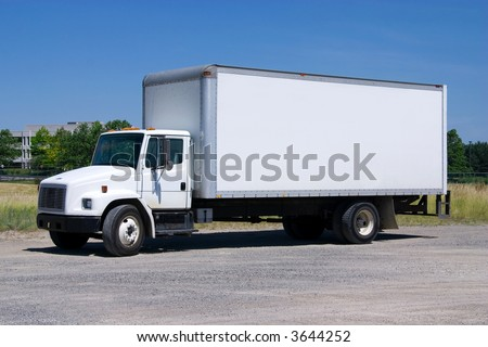This is a picture of a typical six wheel city delivery cargo vehicle with a blank white van box. - stock photo