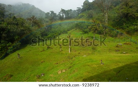 this is a rainbow in the rain forest of Panama - stock photo