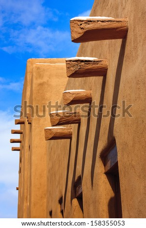 This is a simple architectural study under the warm sunlight and clear skies of Santa Fe New Mexico in early spring with light dusting of snow. - stock photo