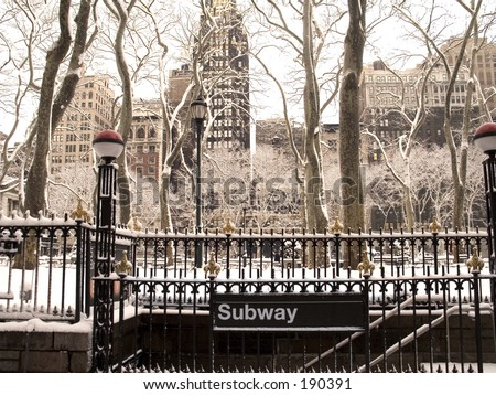 This is a snowy shot of the Bryant Park subway station.  - stock photo