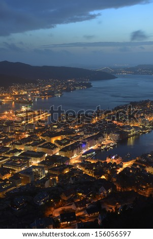This is a top view of Bergen (the west coast of Norway) in night. The town is illuminated. - stock photo