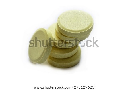 This is a view of calcium tablets on white background. - stock photo