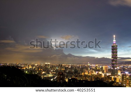 This is a view of Taipei City just after sunset.  The tall building is Taipei 101, which towers over the rest of Taipei. - stock photo
