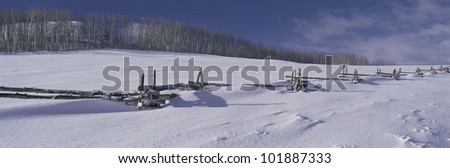 This is a wooden fence nearly buried in snow near Emerald Bay in winter. - stock photo