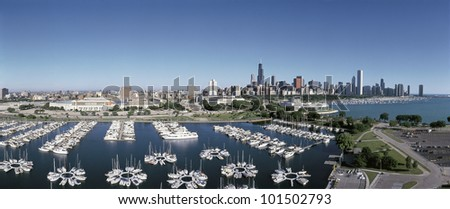 This is an aerial view of the Chicago Harbor and the skyline on Lake Michigan during summer. Boats are moored in the harbor in the foreground. - stock photo