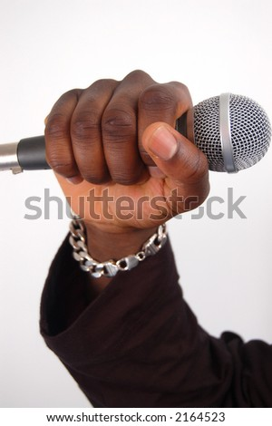 This is an image of a hand on a microphone. - stock photo