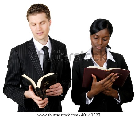 This is an image of a multi ethnic business team reading bibles. - stock photo