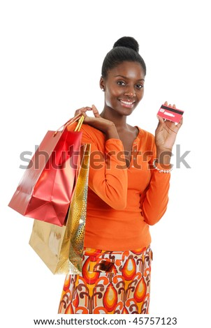 This is an image of a woman holding a shopping bag. - stock photo