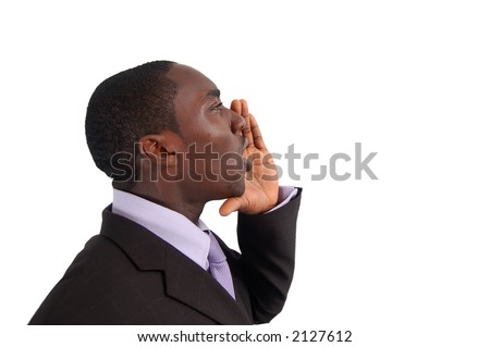 This is an image of business man with his hands near his lips making an annoucement. - stock photo