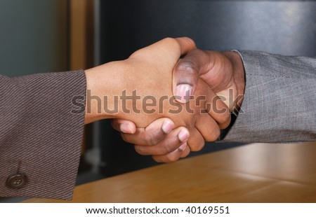 This is an image of male and female handshake at a business reception. - stock photo