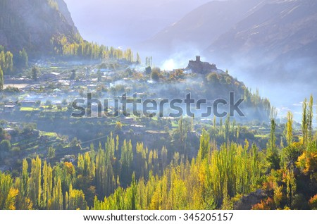 This is Baltit fort with beautiful autumn seasons , backlight  and  the mist in the morning time - stock photo
