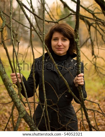 This is beautiful girl in wood. - stock photo