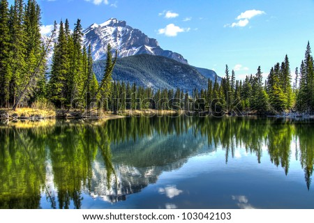 This is Cascade Mountain seen from the edge of the Bow River in Banff National Park, Alberta, Canada. - stock photo