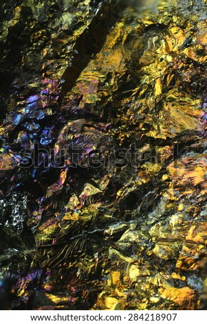 This  is copper ore . A sample of chalcopyrite, an important copper resource.  Photographed through microscope. - stock photo
