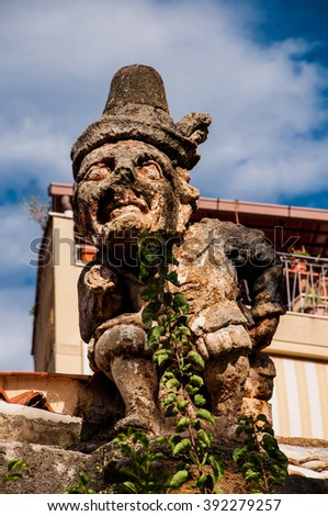 This is famous grotesque statues with human faces that decorate garden and wall of the Villa Palagonia (The Villa of Monsters) near Palermo, Sicily, Italy.
