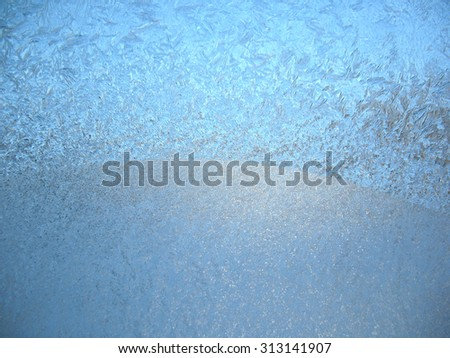 This is frosty pattern on glass winter window - stock photo
