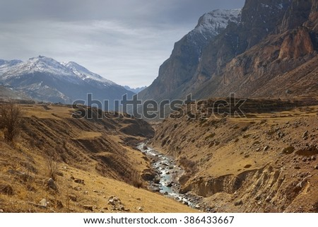 This is gloomy landscape in Caucasus mountains in spring, valley - stock photo