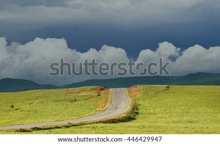 This is light way in gloomy Caucasus mountains in summer - stock photo