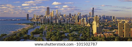 This is Lincoln Park with Diversey Harbor in the foreground and Lake Michigan on the left looking south. It shows the Chicago skyline in morning light in the summer. - stock photo