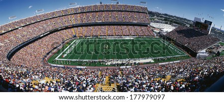 This is Mile High Stadium with the Denver Broncos playing the St. Louis Rams to a sold out crowd. This was an NFL game that took place on 9/14/97. The final score was Denver 35, St. Louis 14. - stock photo