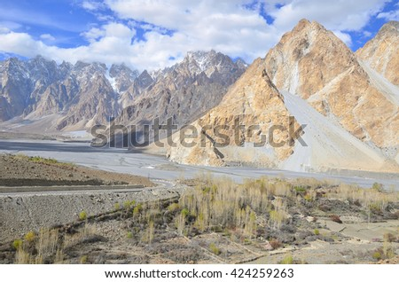 This is Passu Cathedral viewed in spring from the Karakoram Highway near the viewpoint of Passu village , Upper Hunza valley ,northern Pakistan - stock photo