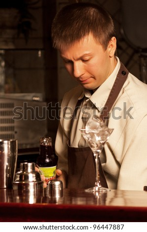This is photograph of a barman at work - stock photo