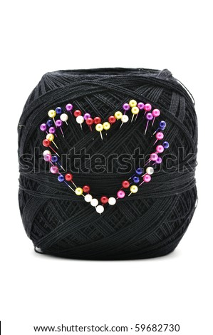 This is Pins on Yarn on isolated shot - stock photo