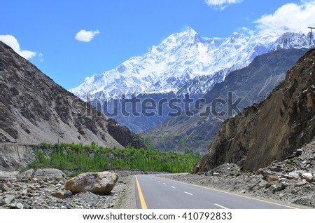 This is Rakaposhi peak  is a mountain in the Karakoram mountain range in Pakistan along the way to Hunza valley  - stock photo