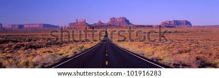This is Route 163 that runs through the Navajo Indian Reservation. - stock photo