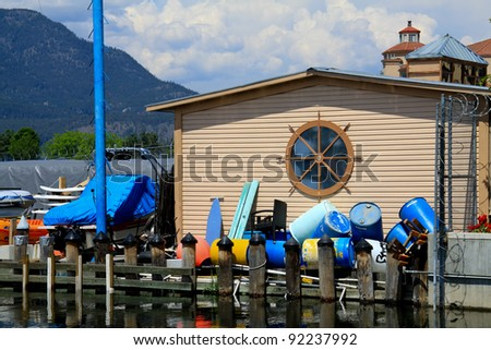 This is the boat house located on the shore of lake Okanagan in British Columbia, Canada. - stock photo
