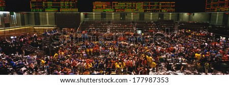 This is the Chicago Board of Trade trading floor. It is where they trade commodity futures such as corn, wheat, and gold. - stock photo