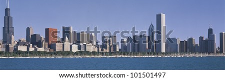 This is the complete Chicago skyline with the Chicago Harbor in the foreground. It is the view in the morning during summer. - stock photo