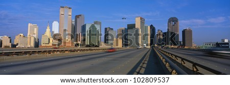 This is the freeway to the center of Dallas with the skyline in the background. - stock photo