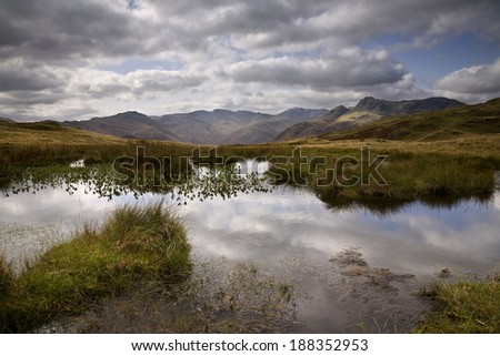 This is the Langdale Valley in the English Lake District viewed from the ridge between Silver How and Blea Rigg. - stock photo