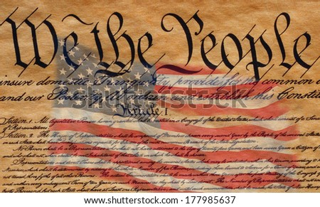 This is the preamble to the U.S. Constitution that starts with the words, we the people - and US Flag superimposed over it.  - stock photo