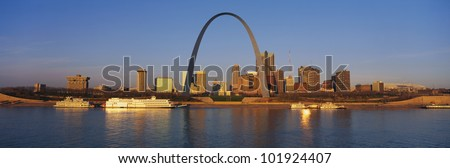 This is the St. Louis skyline at sunrise. It is situated along the Mississippi River. - stock photo