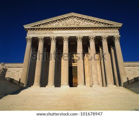 This is the United States Supreme Court against a blue sky. - stock photo